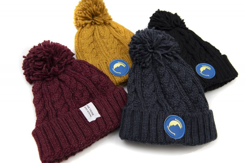 Fritidsklader bobble hats in navy blue, mustard yellow, burgundy and black