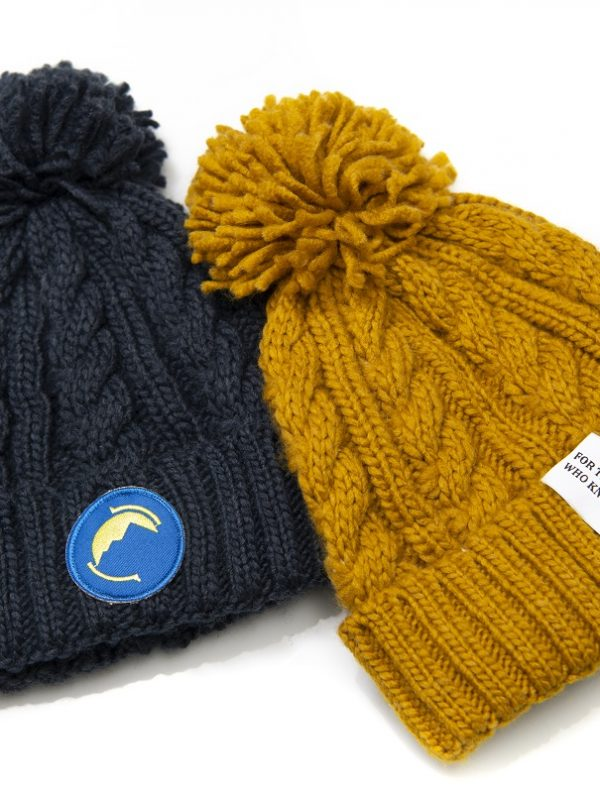 Fritidsklader bobble hats in navy blue& mustard yellow