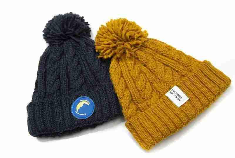 Fritidsklader bobble hats in navy blue& mustard yellow